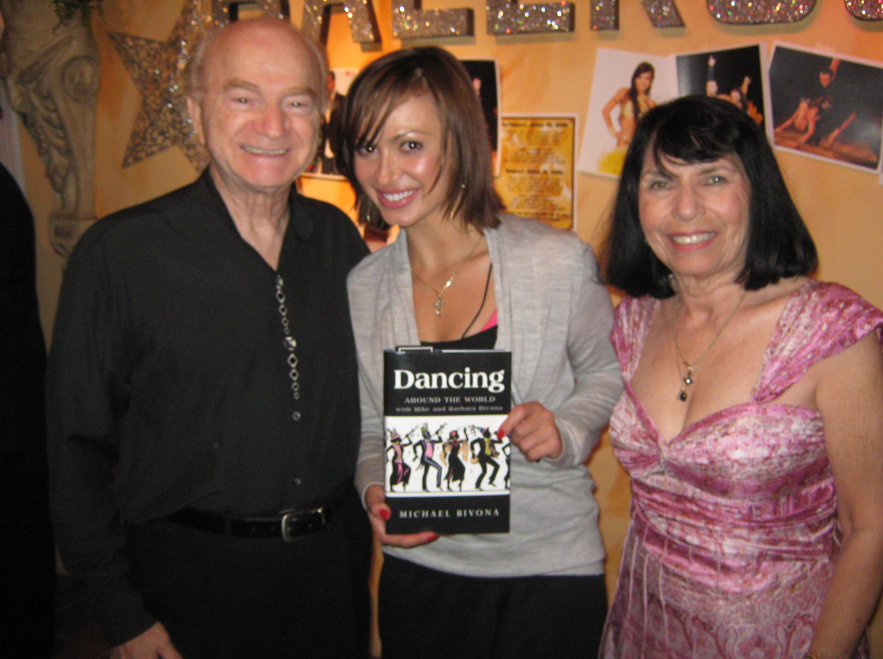 Karina Smirnoff of the popular TV show Dancing With the Stars (DWTS) received a signed copy of Mike Bivona's Book Dancing Around the World with Mike and Barbara. She is featured with two photos dancing with Louis Van Amstel in the book.